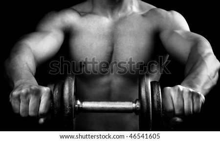 Powerful muscular guy holding a dumbbell - stock photo