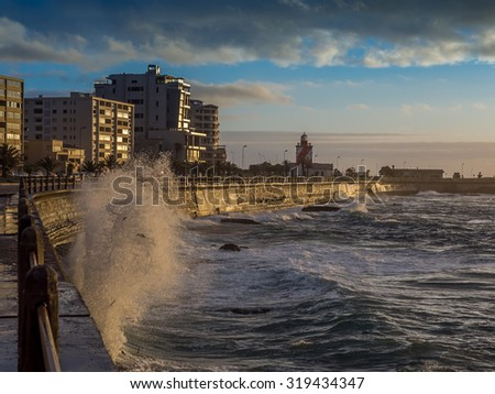 Powerful Ocean waves crushing on the sea promenade in Cape Town - 1 - stock photo