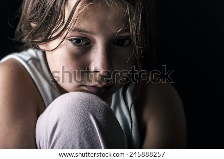 Powerful Shot of Sad Child - stock photo