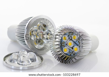 powerful 1W LED lamp with optics to narrow emitted angle, one uncovered - stock photo