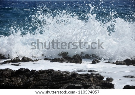Powerful Waves crushing on a rocky beach - stock photo