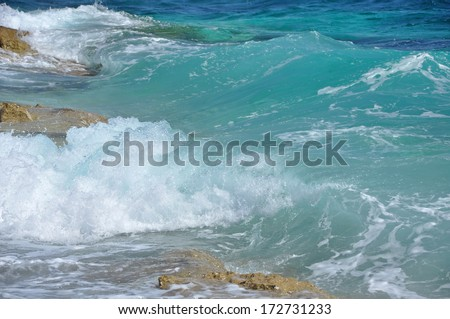 Powerful waves crushing on a rocky beach in Croatia - stock photo