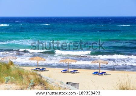 Powerful waves on Elias bay beach on a particularly windy day, Skiathos island, Sporades archipelago, Greece - stock photo