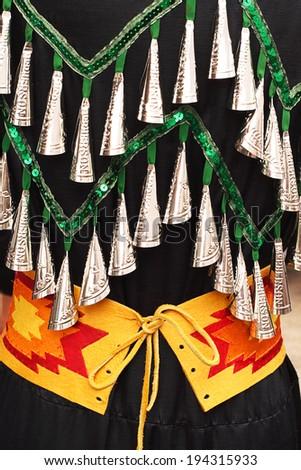 Powwow jingle bell dress on display at Kahnawake, Quebec, Canada July 10, 2011 - stock photo