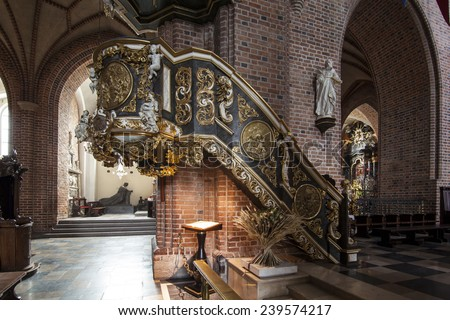 POZNAN, POLAND - DEC 16, 2014: Historic pulpit in The Archcathedral Basilica of St. Peter and St. Paul in Poznan, Poland  - stock photo