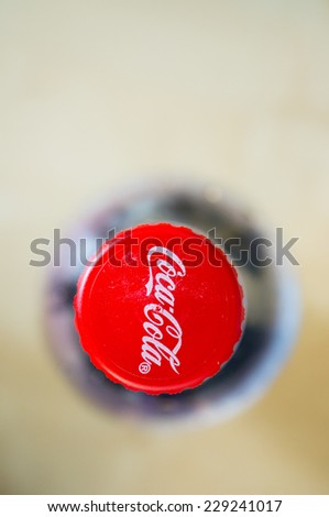 POZNAN, POLAND - FEBRUARY 02, 2014: Close-up of a red Coca Cola bottle cap - stock photo