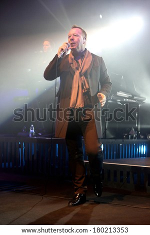 POZNAN, POLAND - MARCH 01: Scottish music band Simple Minds performs at Sala Ziemi MTP March 01, 2014 in Poznan, Poland. - stock photo