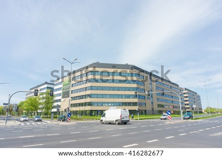 POZNAN, POLAND - MAY 05, 2016: New modern work office building of the Business Garden near a intersection - stock photo