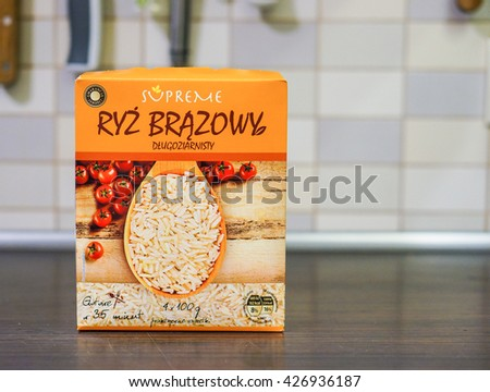POZNAN, POLAND - MAY 16, 2016: Polish Supreme brand rice in a paper box on table - stock photo
