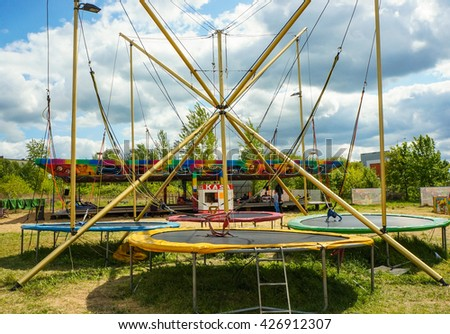 POZNAN, POLAND - MAY 15, 2016: Three jump trampolines at a luna park on a sunny day - stock photo