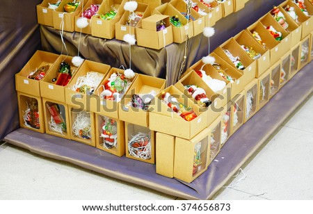POZNAN, POLAND - NOVEMBER 26, 2013: Christmas decoration in boxes for sale in the Galeria Malta shopping mall - stock photo