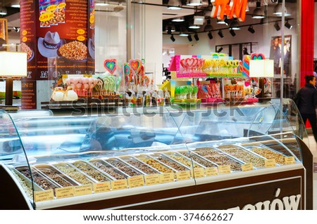 POZNAN, POLAND - NOVEMBER 26, 2013: Stand with nuts and candy in the Galeria Malta shopping mall - stock photo