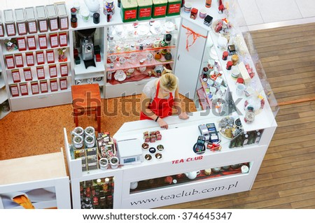 POZNAN, POLAND - NOVEMBER 26, 2013: Woman selling tea by a Tea Club stand in the Galeria Malta shopping mall - stock photo