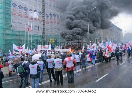 POZNAN, POLAND - OCTOBER 23: Polish 'Solidarnosc' workers from H.Cegielski factory and shipyards on manifestation over pay, unemployment and recession on October 23, 2009 in Poznan, Poland - stock photo