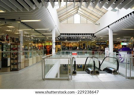 POZNAN, POLAND - OCTOBER 26, 2013: Stores and shops in the Pasaz Rondo shopping mall - stock photo