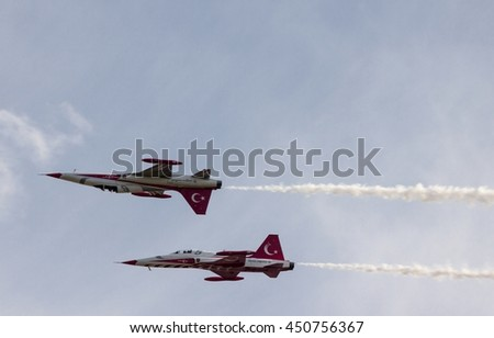 POZNAN, POLAND -SEP 24, 2015: The Turkish Stars are the aerobatic demonstration team of the Turkish Air Force and the national aerobatics team of Turkey. - stock photo