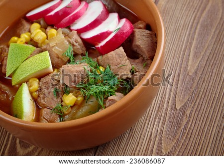 Pozole Poxo - traditional soup Mexico.broth rich soup made with pork, red chiles, radishes, cilantro - stock photo