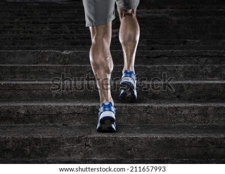 Practice, close up of young man running up the stairs - stock photo