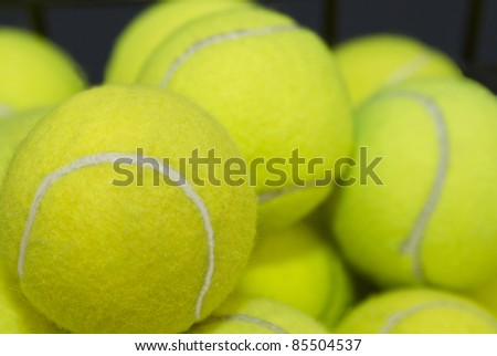 Practice, tennis balls are piled high, waiting for lessons or game preparation. - stock photo