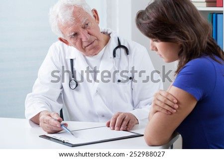 Practiced doctor doing medical interview with patient - stock photo