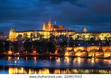 Prague at epic suset, Charles bridge and Prague castle - stock photo
