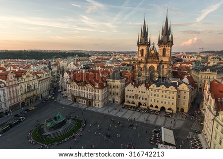 Prague, Beautiful Scenic Aerial View Panorama of Old Town Square Cityscape Orange Roofs and Church of Our Lady before Tyn Famous Landmark with Skyline at Sunset in Summer, Czech Republic - stock photo