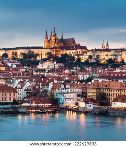 Prague Castle and Mala Strana district across Vltava river in the evening  - stock photo