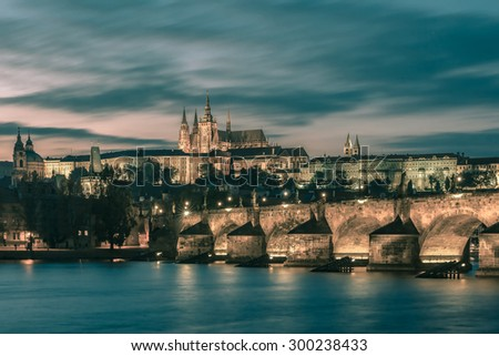 Prague Castle, Charles Bridge and the Little Quarter at sundown, Prague, Czech Republic. Toning in cool tones - stock photo