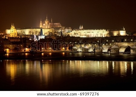Prague Castle from river at night in winter - stock photo