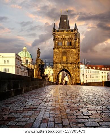 Prague, Charles Bridge in the evening after rain - stock photo