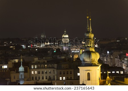 PRAGUE, CZ - NOVEMBER 29: Wenceslas square at night with national museum at the top is always admired by tourists during winter. This year it displays Vaclav Havels photo, Prague, November 29, 2014 - stock photo