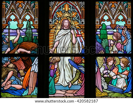 PRAGUE, CZECH REPUBLIC - APRIL 5, 2016: Stained Glass in the Basilica of Vysehrad in Prague, Czech Republic, depicting Jesus rising from the grave - stock photo