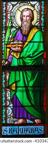 PRAGUE, CZECH REPUBLIC - APRIL 2, 2016: Stained Glass window in St. Vitus Cathedral, Prague, depicting Barnabas, born Joseph, an early Christian, one of the prominent Christian disciples in Jerusalem - stock photo