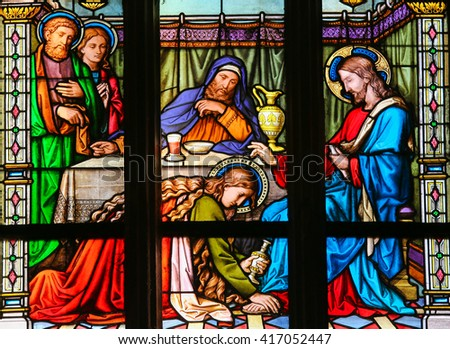 PRAGUE, CZECH REPUBLIC - APRIL 2, 2016: Stained Glass window in St. Vitus Cathedral, Prague, depicting Mary Magdalen anointing Christâ??s feet - stock photo