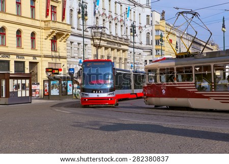 Prague, Czech Republic - April 23, 2015: Trams at old street in Prague. Prague is the capital and largest city of the Czech Republic. - stock photo