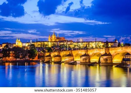 Prague, Czech Republic. Charles Bridge and Hradcany (Prague Castle) with St. Vitus Cathedral and St. George church evening dusk, Bohemia landmark in Praha. - stock photo