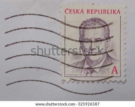 PRAGUE, CZECH REPUBLIC - CIRCA AUGUST 2014: mail stamp bearing the portait of president Milos Zeman - stock photo
