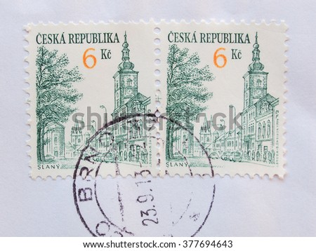PRAGUE, CZECH REPUBLIC - CIRCA DECEMBER 2013: envelope with two Czech stamps showing the town of Slany - stock photo
