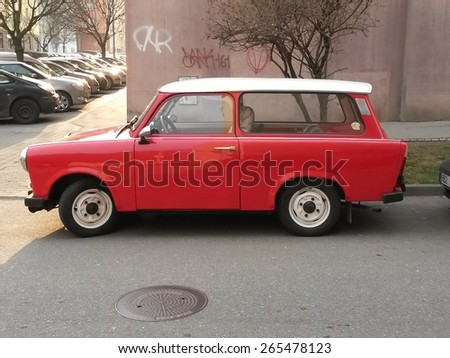 PRAGUE, CZECH REPUBLIC - CIRCA MARCH 2015: Red Trabant car parked in a street of the city centre - stock photo