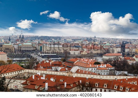 PRAGUE, CZECH REPUBLIC - DECEMBER 30 : Top cityscape view of Prague with historical gothic architecture, on cludy blue sky bakcground. - stock photo