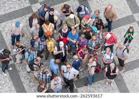PRAGUE, CZECH REPUBLIC - JUL 21: Top view group of unknown tourists waiting at the old town square in the center of the Czech capital city on July 21, 2009 in Prague, Czech Republic - stock photo