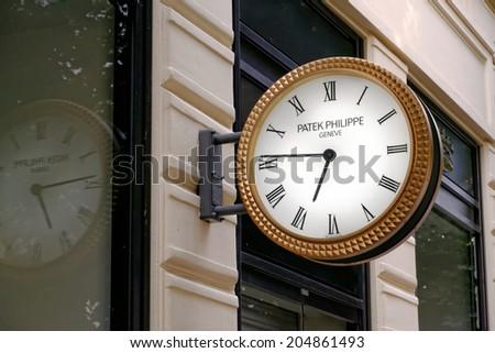 PRAGUE, CZECH REPUBLIC - JULY 5, 2014: Outdoor analog clock Patek Philippe from  Geneve mounted on a wall in Praha 1, Josefov, Parizska str. - stock photo