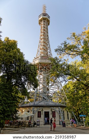 PRAGUE, CZECH REPUBLIC - JULY 3, 2014: The Petrin lookout tower on Petrin Hill. It is built in 1891 and is a 63.5 metre high. It resembles the Eiffel Tower and is a major tourist attraction. - stock photo