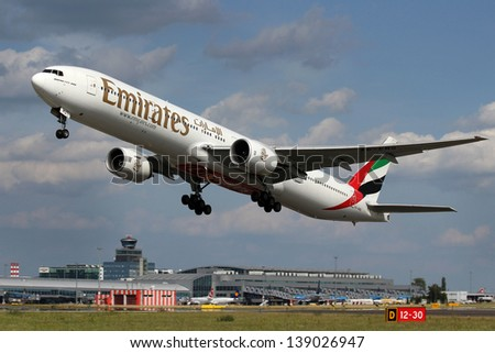 PRAGUE, CZECH REPUBLIC - JUNE 28: Emirates Boeing 777-31H takes off from PRG Airport on June 28, 2012. Emirates is rated as a top 10 best airlines in the world flying on youngest fleet. - stock photo
