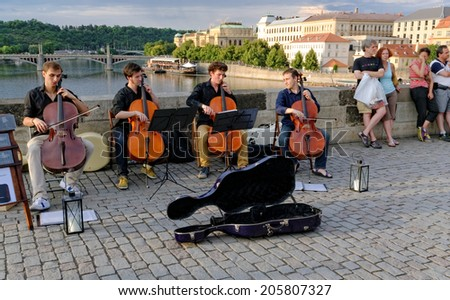 PRAGUE, CZECH REPUBLIC - JUNE 05, 2014. Musicians perform live on Charles Bridge in Prague, Czech Republic on June 5, 2014. The construction of the bridge started in 1357 under King Charles IV. - stock photo
