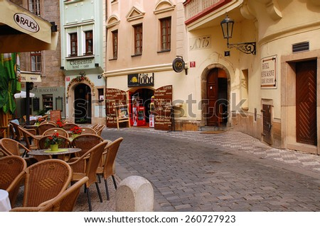 PRAGUE, CZECH REPUBLIC - JUNE 8, 2008: Old cobbled deserted street in the center of the city - stock photo