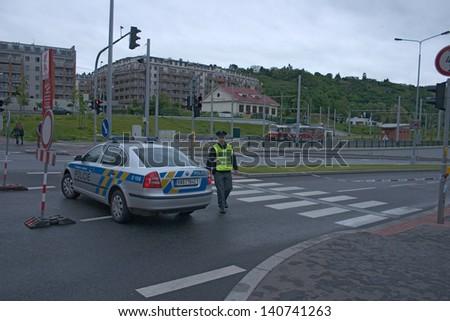 PRAGUE, CZECH REPUBLIC - JUNE 2: Policemen blocking street off in Prague, Dejvice, because of the flooding on June 2, 2013 in Prague, Czech Republic - stock photo