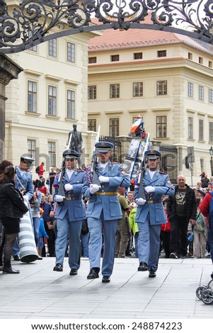 PRAGUE, CZECH REPUBLIC - JUNE, 21st, 2014: Castle guards (Hradni straz) of presidental palace during ceremonial changing of guards in Prague, Czech republic, on 21st June 2014. - stock photo