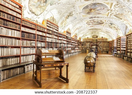 PRAGUE, CZECH REPUBLIC - JUNE 15, 2014: The Theological Hall in Strahov monastery in Prague, one of the finest library interiors in Europe.  - stock photo