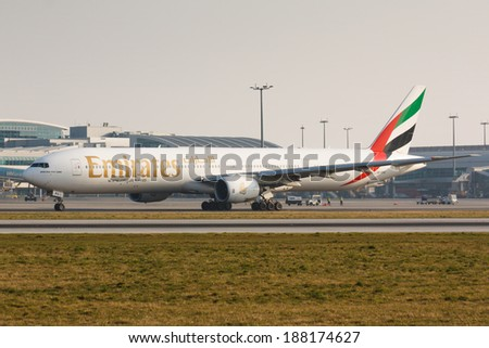 PRAGUE, CZECH REPUBLIC - MARCH 14: Boeing 777-300 Emirates taxis for take offl in PRG Airport on March 14, 2014. Emirates is an airline based in Dubai. - stock photo
